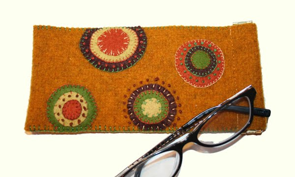 eyeglass case with circles, shown with glasses beside