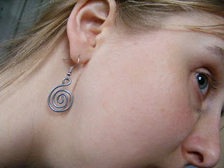 Valerie wearing a silver spiral earring she designed