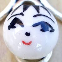 Bola porcelana con cara
