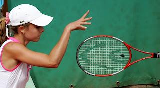 Alize Cornet tosses her racquet