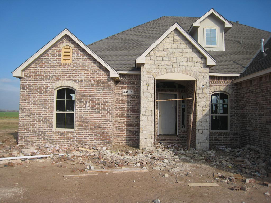 The martin 39 s new home 15 brick stone and stucco for Stone and brick
