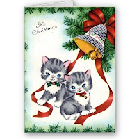 cute kitten wishing merry christmas