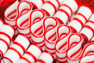 red and white christmas ribbon candy wallpaper
