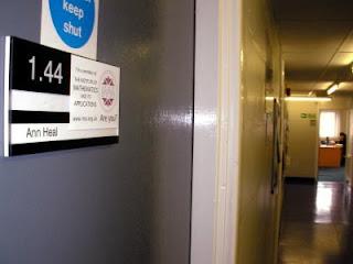 IMA Sticker on Ann Heal's door