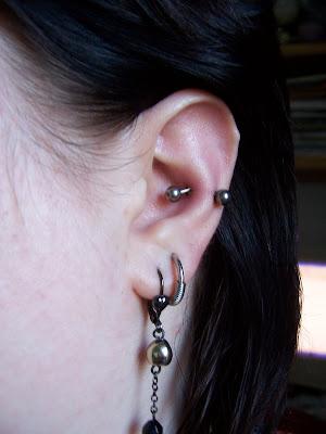 ear lobe piercings. my ear with metal!