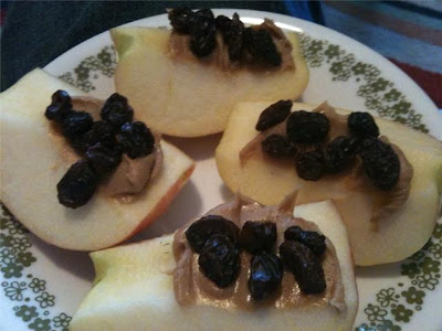Apples with peanut butter and raisins