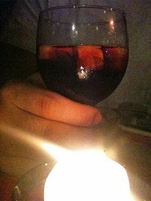 Kale's hand on a glass of Sangria
