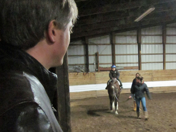 Thomas rides a horse as his dad, my brother, looks on proudly.