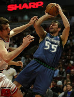 Minnesota Timberwolves Player shooting the ball