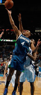 Timberwolves #4 takes the ball to the hoop