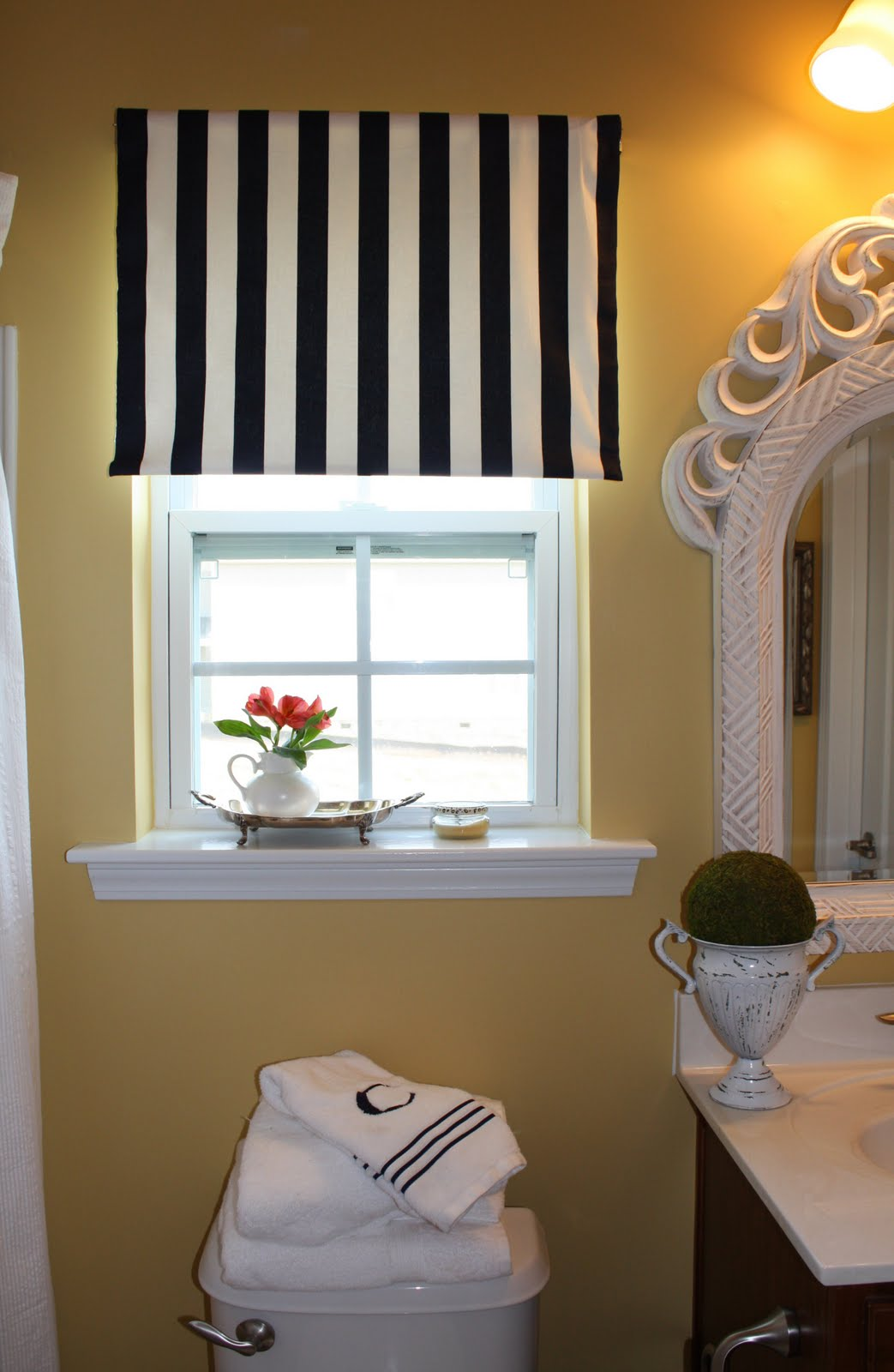 Easy (and Inexpensive) DIY Fabric Roller Shade - Emily A. Clark