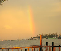 a rainbow at sunset on nassau harbour