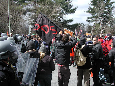 Police in riot gear confront demonstrators at the GW Parkway