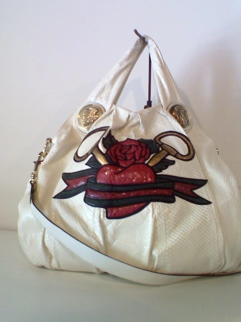 White python with gucci tattoo heart patchwork, white leather trim,