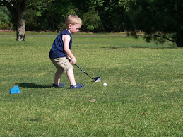 Trying Out His New Clubs