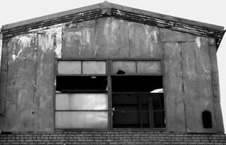 Broken Warehouse Windows in a Flats building