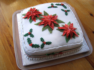 A Christmas Cake decorated with poinsettias and holly