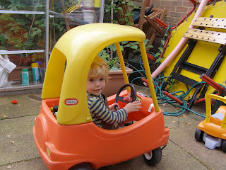 Alex driving his red and yellow car