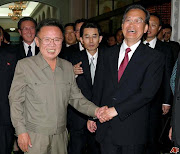 North Korea's Kim Jongil (left) and (wen jiabao kim jong il )
