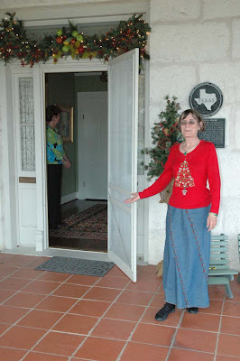 A docent welcomes guests inside a historic Fredericksburg home during last year's Holiday Home Tour. This year's Preservation Weekend on Dec 12 and 13 features eight unique properties, as well as the Tannenbaum Ball.