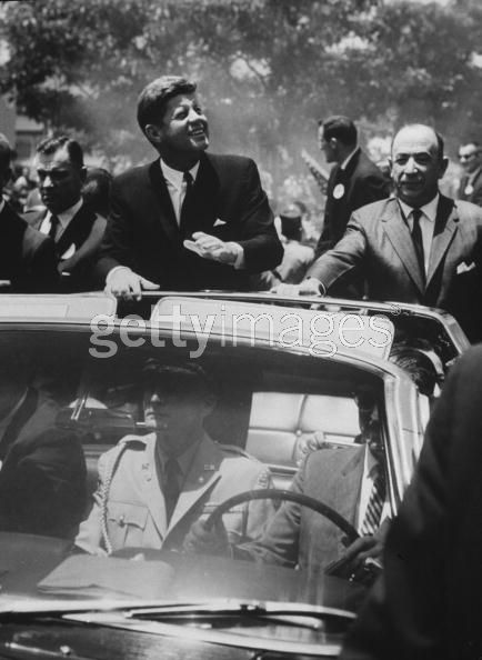 Agents (inc Kellerman) on/ near rear of car March 1963; military aide in front seat