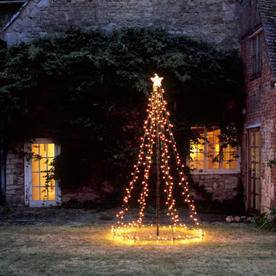 How sweet is this outdoor Christmas tree It looks especially nice when