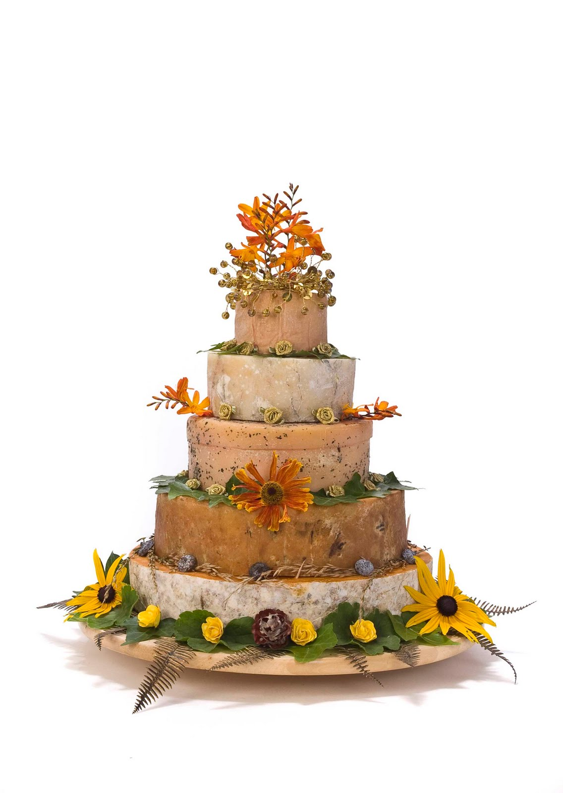 wedding cakes made out of cheese wheels by t he cheese shed yes please