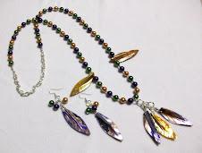 Cod Col 2260 Collar de perlas en colores verde, lila y oro