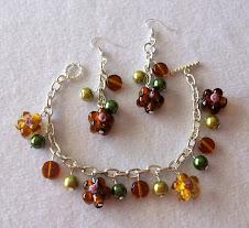 Cod 2263 Pulsera de cristales flor y perlas