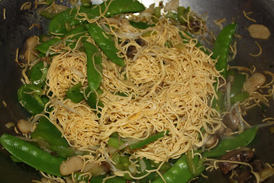 Chow Mein Noodles with Snow Peas in Skillet