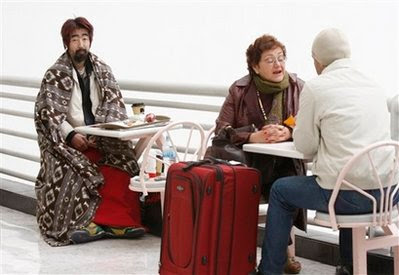 Hiroshi Nohara sits in Mexico City's main international airport