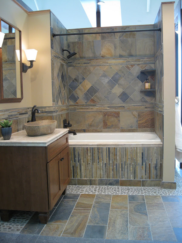 Here's a shower with Carara Gris and the new Brookfield mosaic (one of  title=