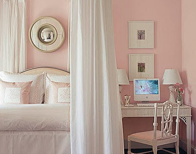 The simple shape of the cartia padded headboard looks feminine and pretty in this pink bedroom.