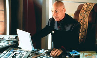 Jean-Luc Picard surrounded by Kindles, Nooks, and Sony EReaders