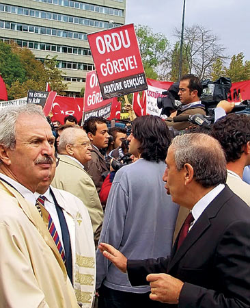 "Kemal Guruz (at right) - Kemal Alemdaroglu (at left) - poster : ""inviting junta to coup d'etat"""