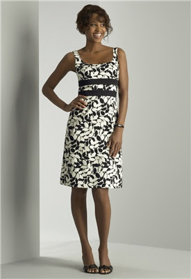 A model shows of Donna Ricco's Sleeveless Banded Waist Short Dress worn by Michelle Obama