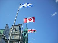 Las banderas de Québec, Canadá y Montreal juntas