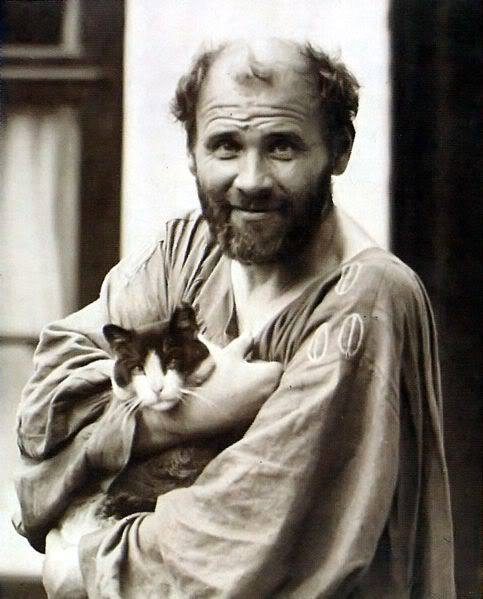 artist Gustav Klimt holding his cat