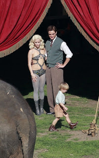 Robert Pattinson and Reese Witherspoon kissing on the set of Water for Elephants