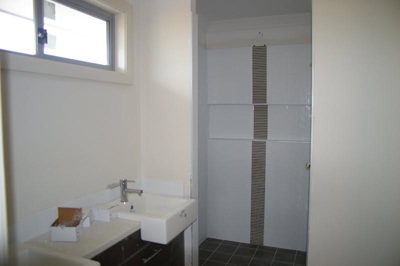 towards shower feature tile strip same design in main bathroom shower title=