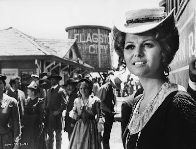 Musical score: Claudia Cardinale gets off the train in the bustling town of ...