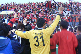 Pohang players celebrate with fans