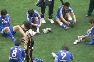 Suwon players get ready to warm down