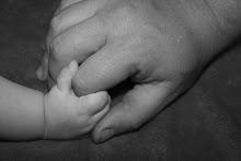 Tango holding Evan's hand