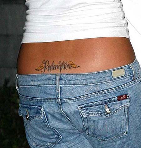 located on her bikini line, plus a musical note behind her right ear.