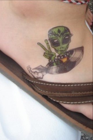 Alien spaceship peace sign tattoo pic.