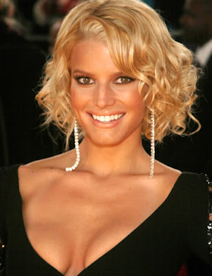 Jessica Simpson short curly hairstyle.