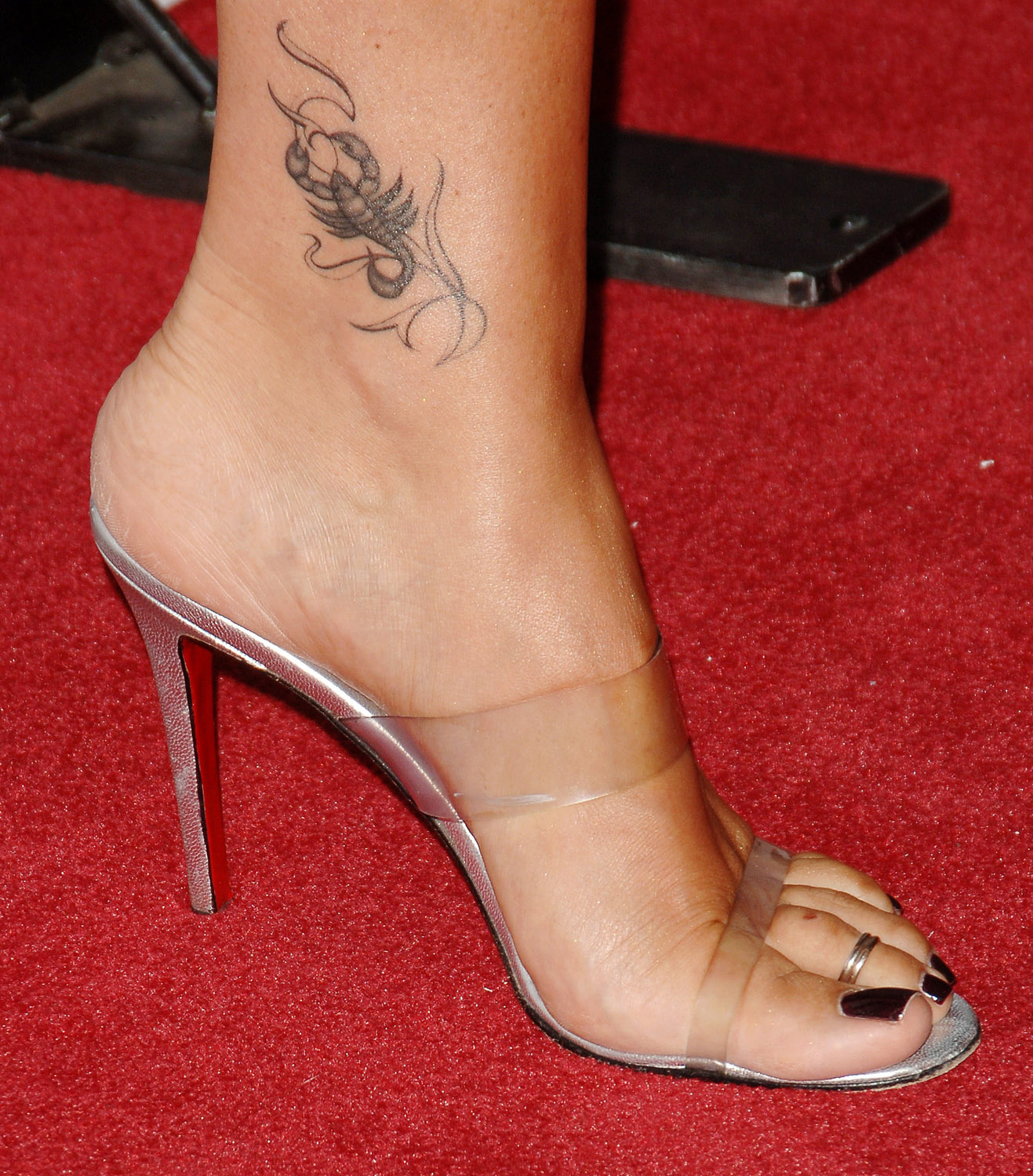 Daisy Fuentes closeup tattoo picture.