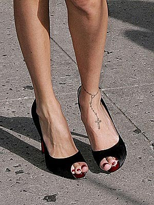 bow tattoo on ankle. Nicole Richie ankle tattoo.