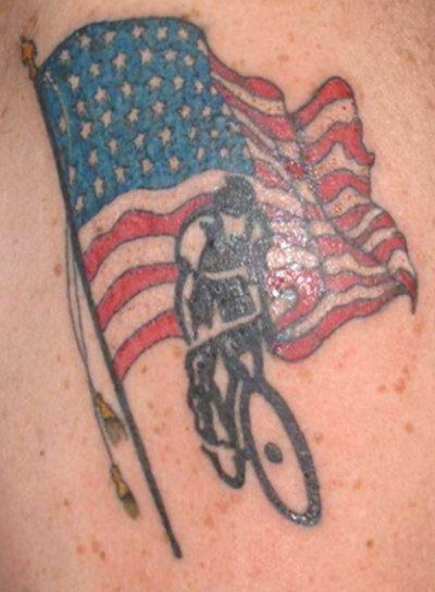 American flag with bike rider tattoo.